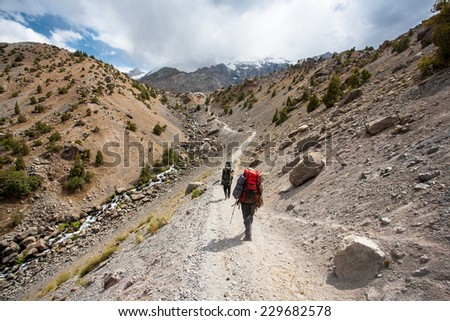 Group of hikers in Fann mountains, central asia, Tajikistan. - stock photo