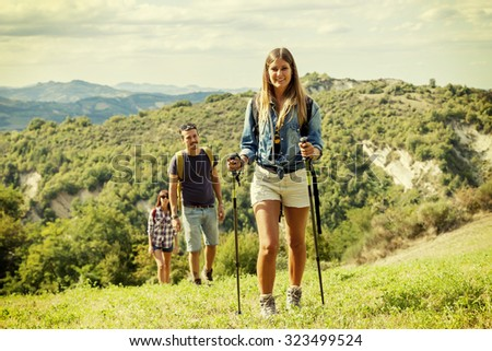 group of hikers in the mountain in single file - stock photo