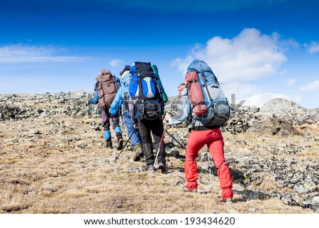 group of hikers in the mountains  - stock photo