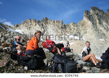 group of hikers taking a rest after descending - stock photo