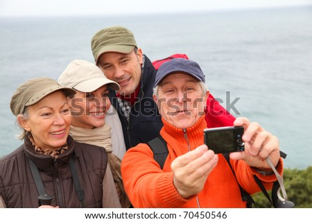 Group of hikers taking picture of themselves - stock photo
