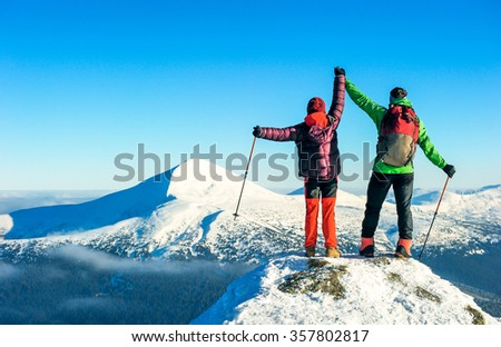 Group of hikers trekking in the winter mountains. Sport and active life