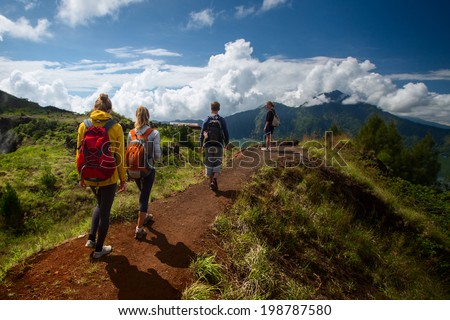 Group of hikers walking in the caldera of volcano of Batur, Bali, Indonesia - stock photo