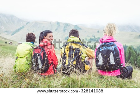 Group of hikers watching the scene in the fog. concept about sport, activity, friendship and people