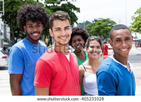 Group of hip young adults with walking in city - stock photo