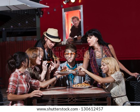 Group of Hipsters eating pizza at a mobile cafe