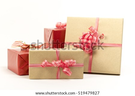 Group of holiday gift boxes decorated with ribbon isolated on white background.