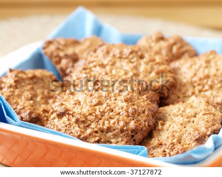 Group of homemade oats cookies closeup on a dish - stock photo