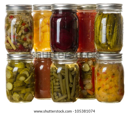 Group of homemade preserves canned goods in mason jars - stock photo
