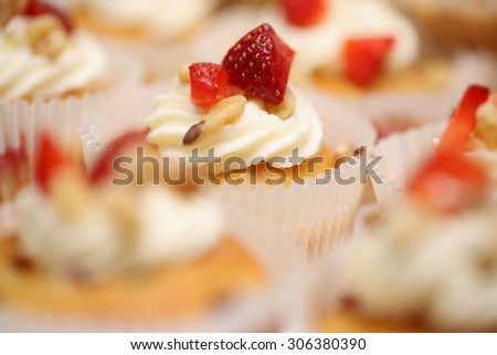 Group of homemade strawberry cupcakes with the focus made on one.