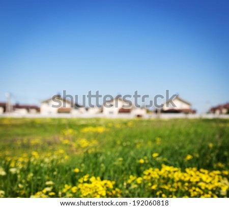 Group of houses in the countryside. Defocused photo - stock photo