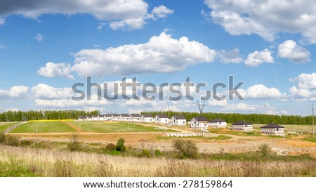 Group of houses in the countryside. Sunny summer day - stock photo