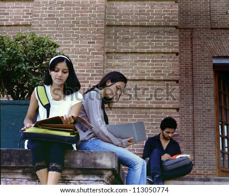 Group of Indian / asian college students studying together at the campus. - stock photo