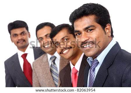 Group of Indian business people posing to the camera.