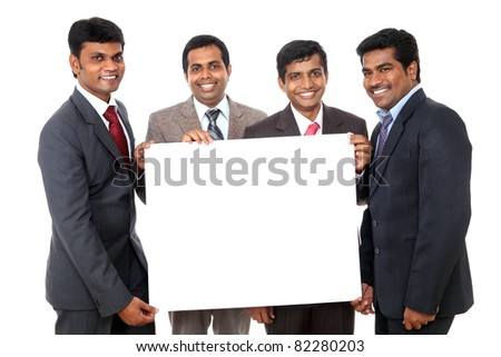 Group of Indian business people posing with white board