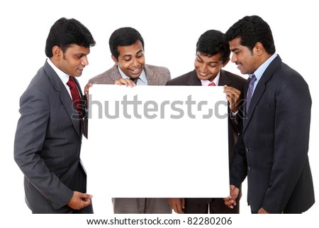 Group of Indian business people posing with white board - stock photo