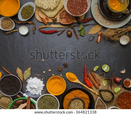Group of indian spices and herbs on stone background, Top view mix indian spices and herbs difference ware on stone background with copy space for design vegetable, spices, herbs or foods content. - stock photo
