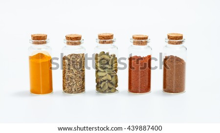 Group of indian spices and herbs on white background, Group of indian spices and herbs difference ware on white background with copy space for design vegetable, spices, herbs or foods content. - stock photo