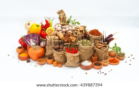 Group of indian spices and herbs on white background, normal view mix indian spices and herbs difference ware on white background with copy space for design vegetables, spices, herbs or foods content. - stock photo