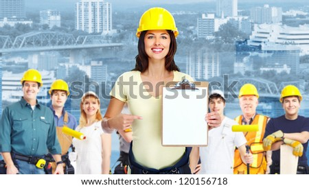 Group of industrial workers. Over blue background. - stock photo
