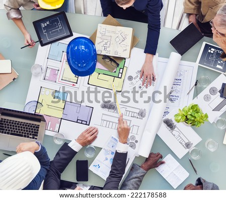 Group of Interior Designers Working Together - stock photo