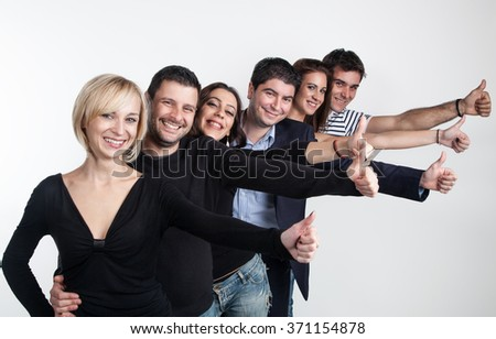 Group of international people who shows their thumb up - stock photo