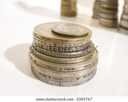 Group of isolated coins. Tower of coins