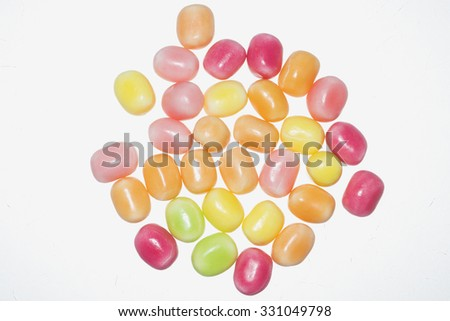 Group of jelly beans on white background