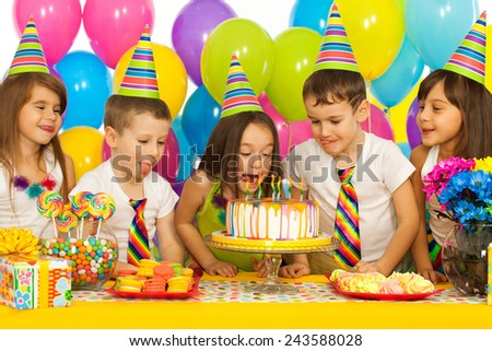 Group of joyful little kids with cake at birthday party. Holidays concept. - stock photo