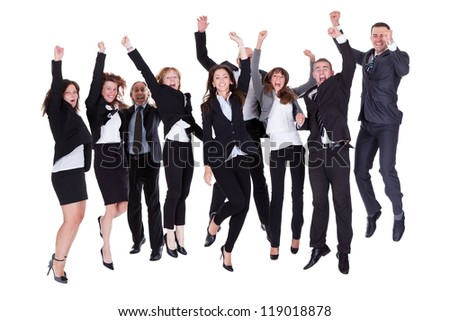 Group of jubilant business people jumping for joy and shouting in their excitement at their success isolated on white - stock photo
