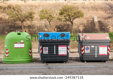 Group of kerbside waste dumpsters. - stock photo
