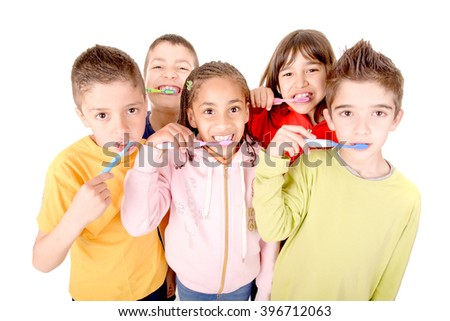 group of kids brushing teeth isolated in white