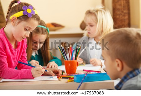 Group of kids draw at classroom.Preschool.