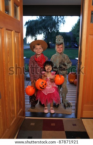 Group of kids dressed up for Halloween - stock photo