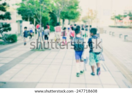 Group of kids going to school together, motion blurr - stock photo
