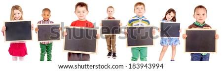 group of kids holding blackboards - stock photo