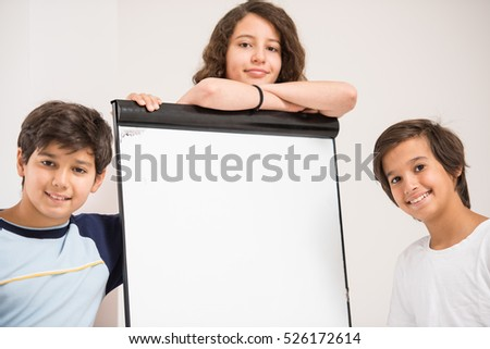 Group of kids holding white board as copy space