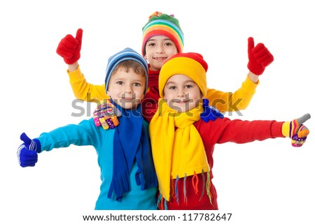 Group of kids in bright winter clothes and ok sign, isolated on white