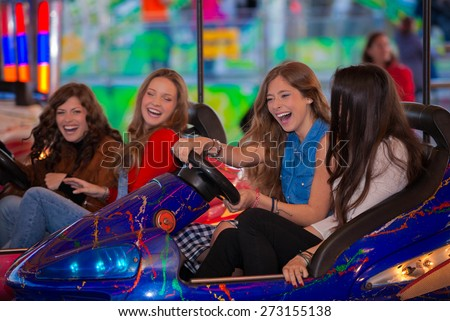 group of kids or girls having fun at fair.