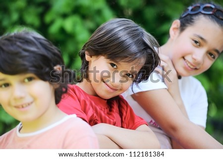 Group of kids outdoors - stock photo