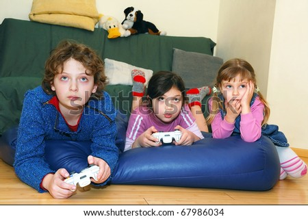 group of kids playing a video game