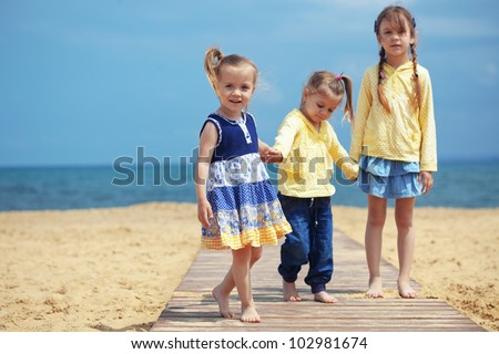 Group of kids playing at the beach - stock photo