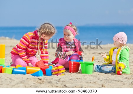 Group of kids playing with constructor - stock photo