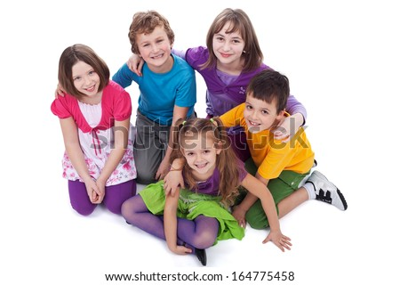 Group of kids sitting on the floor holding to each other - isolated - stock photo