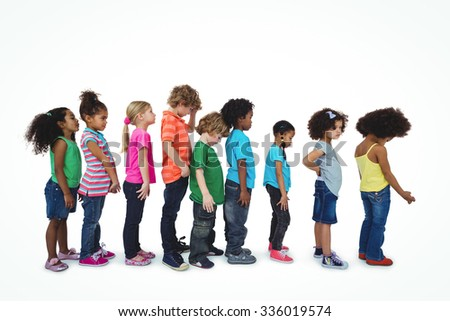 Group of kids standing in a line against a white background - stock photo