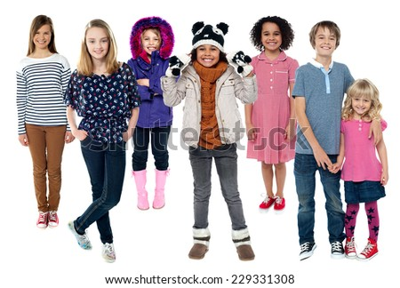 Group of kids standing together in trendy attire - stock photo