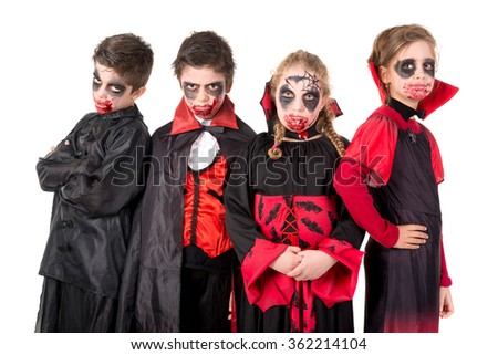 Group of kids with face-paint and Halloween vampire costumes  - stock photo