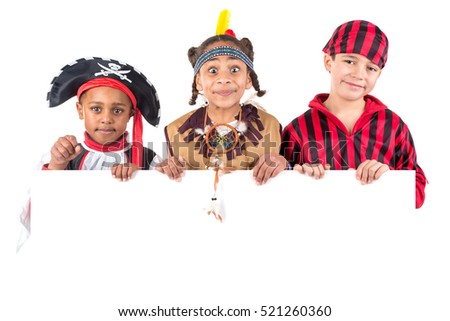 Group of kids with Halloween costumes over a white board isolated in white