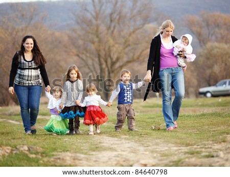 Group of kids with parents walking outdoors