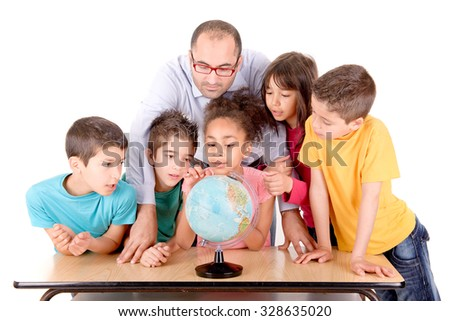 group of kids with teacher looking at globe at school isolated in white - stock photo